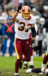 December 13, 2009; Oakland, CA, USA;  Washington Redskins safety Reed Doughty (37) celebrates after sacking Oakland Raiders quarterback Bruce Gradkowski (not pictured) during the first quarter at Oakland-Alameda County Coliseum.  Washington defeated Oakland 34-13.