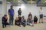 Deadpool actor Ed Skrein (far left) and members of the Phoenix Rising cast watch on during rehearsals in a former Santander building near Great Portland Street.<br /> The full-scale production, which runs from 8th Nov - 2nd of Dec 2017 under Smithfield Meat Market, has been put together by charity The Big House, a charity that helps troubled youths who have been in care.