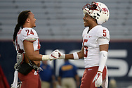 TUCSON, AZ - OCTOBER 28:  Running back Keith Harrington #24 and wide receiver Travell Harris #5 of the Washington State Cougars shake hands prior to the game against the Arizona Wildcats at Arizona Stadium on October 28, 2017 in Tucson, Arizona. The Arizona Wildcats won 58-37.  (Photo by Jennifer Stewart/Getty Images)