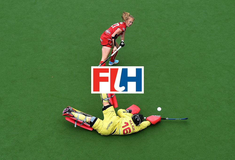 BRUSSELS, BELGIUM - JULY 2: Maria Ruiz of Spain saves a penalty from Jill Boon of Belgium in the shoot out during the Fintro Hockey World League Semi-Final 7/8th playoff game between Spain and Belgium on July 2, 2017 in Brussels, Belgium. (Photo by Charles McQuillan/Getty Images for FIH)