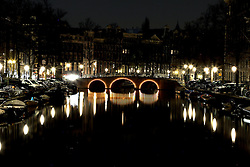 Amsterdam is the largest city and the capital of the Netherlands. Amsterdam has a population of 783,364 within city limits, an urban population of 1,209,419 and a metropolitan population of 2,158,592. The city is in the province of North Holland in the west of the country. It comprises the northern part of the Randstad, one of the larger conurbations in Europe, with a population of approximately 7 million..Its name is derived from Amstelredamme,[9] indicative of the city's origin: a dam in the river Amstel. Settled as a small fishing village in the late 12th century, Amsterdam became one of the most important ports in the world during the Dutch Golden Age, a result of its innovative developments in trade. During that time, the city was the leading center for finance and diamonds.  <br /> <br /> In the 19th and 20th centuries, the city expanded, and many new neighborhoods and suburbs were formed. The 17th-century canals of Amsterdam (in Dutch: 'Grachtengordel'), located in the heart of Amsterdam, were added to the UNESCO World Heritage List in July 2010.