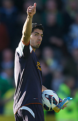 NORWICH, ENGLAND - Saturday, September 29, 2012: Liverpool's hat-trick hero Luis Alberto Suarez Diaz walks off with the match-ball after the 5-2 victory over Norwich City during the Premiership match at Carrow Road. (Pic by David Rawcliffe/Propaganda)