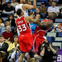 January 29, 2012; New Orleans, LA, USA; Atlanta Hawks forward Ivan Johnson (44) draws a foul from New Orleans Hornets shooting guard Xavier Henry (4) during the second half of a game at the New Orleans Arena. The Hawks defeated the Hornets 94-72.  Mandatory Credit: Derick E. Hingle-US PRESSWIRE