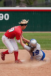 15 April 2012:  Sam West slides in safely under the tag from Lindsey Greene during an NCAA women's softball game between the Drake Bulldogs and the Illinois State Redbirds on Marian Kneer Field in Normal IL
