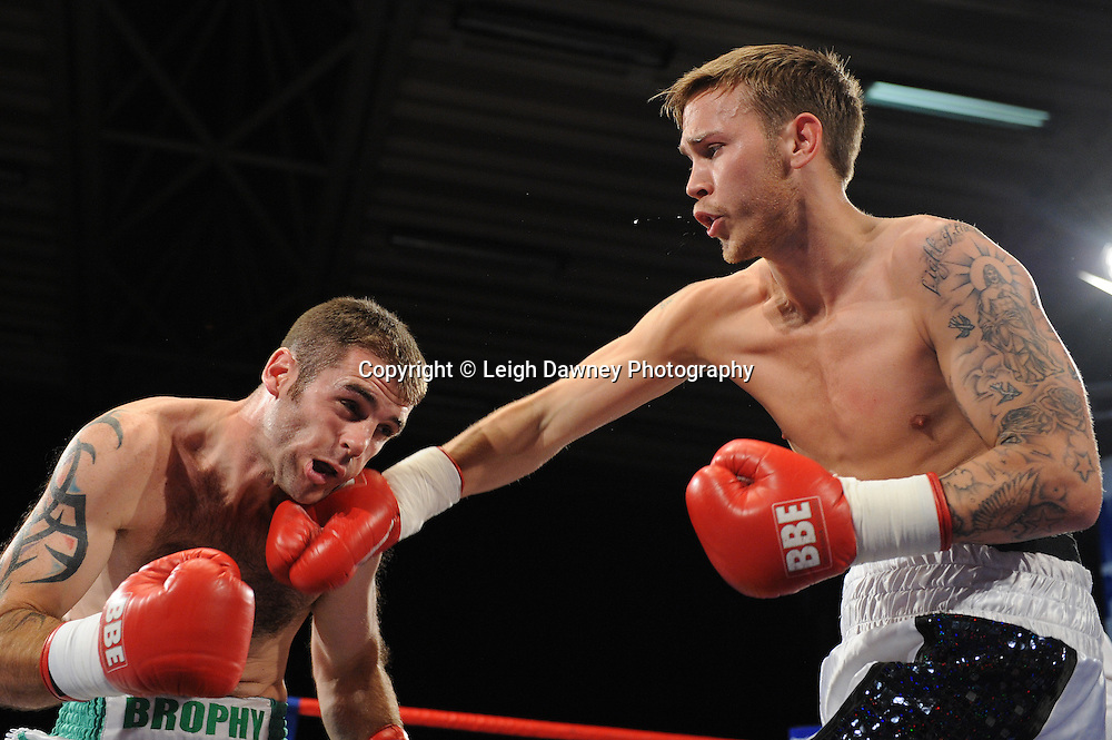 J J Bird (white/black shorts) defeats Chris Brophy in a Light Middleweight contest at the Doncaster Dome, Doncaster, Uk, 3rd September 2011. Frank Maloney Promotions. Photo credit: Leigh Dawney 2011