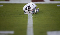 Texas A&M helmets sit on the 50 yard line before the start of an NCAA college football game against South Carolina Saturday, Sept. 30, 2017, in College Station, Texas. (AP Photo/Sam Craft)