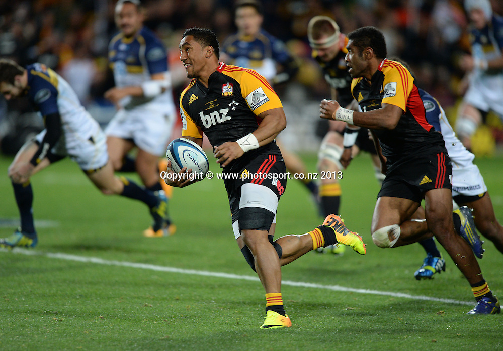 Chiefs player Bundee Aki makes a break. Super Rugby Final. Chiefs v Brumbies. Waikato Stadium, Hamilton, New Zealand on Saturday 3 August 2013. Photo: Andrew Cornaga/www.Photosport.co.nz
