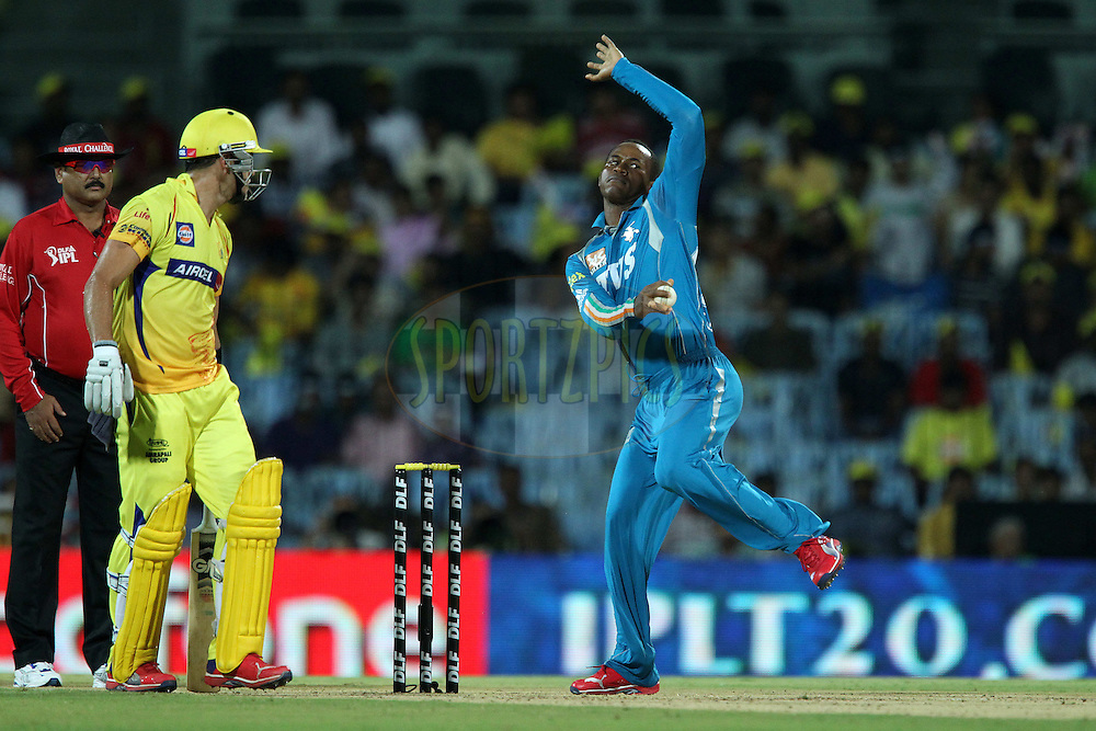 Marlon Samuels bowls whilst Faf du Plessis looks on during match 24 of the the Indian Premier League ( IPL) 2012  between The Chennai Superkings and the Pune Warriors India held at the M. A. Chidambaram Stadium, Chennai on the 19th April 2012..Photo by Ron Gaunt/IPL/SPORTZPICS