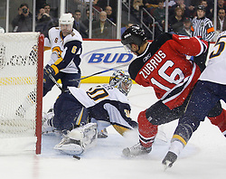 December 28, 2007; Newark, NJ, USA;  Buffalo Sabres goalie Ryan Miller (30) makes a save on New Jersey Devils center Dainius Zubrus (16) during the second period at the Prudential Center in Newark, NJ.