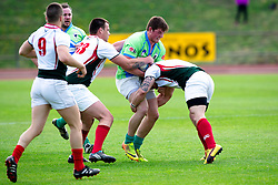 Frankie Skofic tackled during rugby match between National team of Slovenia (green) and Bulgaria (white) at EUROPEAN NATIONS CUP 2012-2014 of C group 2nd division, on April 12, 2014, at ZAK Stadium, Ljubljana, Slovenia. (Photo by Matic Klansek Velej / Sportida.com)