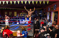 """Tommy Mack """"Master of Mayhem"""" celebrates his win with the crowd at the Whiskey Barrel's Injustice for Brawl event Saturday evening.  (Karen Bobotas/for the Laconia Daily Sun)"""