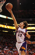 Apr 18, 2010; Phoenix, AZ, USA; Phoenix Suns guard Steve Nash (13) puts up a basket during the second quarter in game one in the first round of the 2010 NBA playoffs at the US Airways Arena.  Mandatory Credit: Jennifer Stewart-US PRESSWIRE