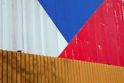 Die tschechische Flagge an einem Fabrikgebaeude in der Stadt Mlada Boleslav wo sich die Skoda Autowerke befinden. Mlada Boleslav liegt noerdlich von Prag und ist ungefaehr 60 Kilometer von der tschechischen Haupstadt entfernt. Skoda Auto besch&auml;ftigt in Tschechien 23.976 Mitarbeiter (Stand 2006), den Grossteil davon in der Zentrale in Mlada Boleslav. Damit sind mehr als 3/4 aller Erwerbst&auml;tigen der Stadt in dem Automobilkonzern t&auml;tig.<br /> <br />                                          Czech flag on a factory building in the city of Mlada Boleslav. The city is located north of Prague and about 60 km away from the Czech capital. Skoda Auto has about 23.976 employees (2006) in Czech Republic and a big part of them is working in Mlada Boleslav. 3/4 of the working population in Mlada Boleslav is working for the Skoda Auto company.