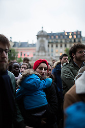 """Women holding a baby and praying An evening of prayer and songs organized by Catholics community the day after Notre Dame Cathedral blaze with a march organized from Saint-Sulpice church to Saint Michel and finally next to Notre Dame Cathedral in Paris early on April 16 the day after the beginning of the fire , 2019. A huge fire that devastated Notre-Dame Cathedral is """"under control"""", the Paris fire brigade said early on April 16 after firefighters spent hours battling the flames. Photo by Raphael Lafargue/ABACAPRESS.COM"""