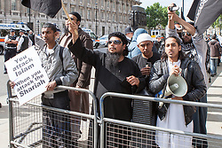 © Licensed to London News Pictures . 20/06/2010 . London , UK . Afsor Ali , also known as Abu Assadullah (right, with megaphone) . A Muslims Against Crusades demonstraion calling for Sharia Law for All , on Richmond Terrace , Whitehall , opposite Downing Street . Photo credit: Joel Goodman/LNP