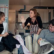 Rosa Emilia Giancola, 44 anni, operaia e delegata RSU FEMCA CISL per la Tacconi Sud di Latina, e' ritratta mentre discute animatamente con le sue colleghe durante un momento di assemblea nel soggiorno nell'appartamento, situato all'interno dello stabilimento, prima riservato al direttore di produzione, dove ora vivono le operaie giorno e notte. Seduti sul divano, Silvana Romano anni 38 ed Ernesto, marito dell'operaia Antonella Arduini, che ha accompagnato la moglie al presidio. L'occupazione e' iniziata il 19 gennaio 2011 a seguito della comunicazione del licenziamento di tutte le dipendenti. La produzione dell'impianto e' ferma e l'intento delle donne e' quello di salvaguardare i materiali ancora al suo interno e di chiedere garanzie per il loro futuro lavorativo. Rosa e Silvana hanno lavorato alla Tacconi Sud per 20 anni.