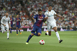 August 16, 2017 - Madrid, Spain - Luis Suarez and Varane looking for the ball. Real Madrid defeated Barcelona 2-0 in the second leg of the Spanish Supercup football match at the Santiago Bernabeu stadium in Madrid, on August 16, 2017. (Credit Image: © Antonio Pozo/VW Pics via ZUMA Wire)