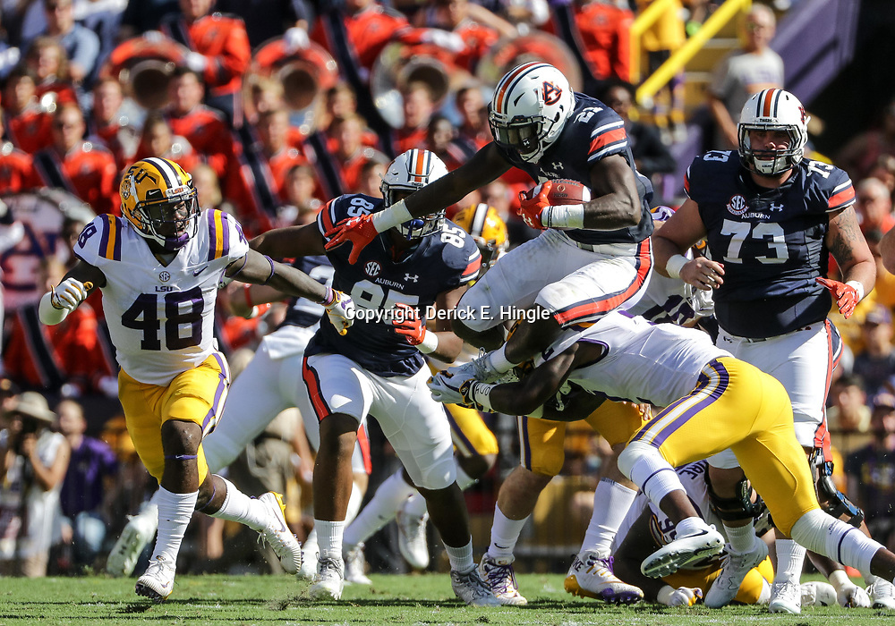 Oct 14, 2017; Baton Rouge, LA, USA; Auburn Tigers running back Kerryon Johnson (21) hurdles LSU Tigers cornerback Kevin Toliver II (2) during the first half of a game at Tiger Stadium. Mandatory Credit: Derick E. Hingle-USA TODAY Sports
