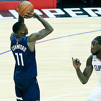 06 December 2017: Minnesota Timberwolves guard Jamal Crawford (11) takes a jump shot over LA Clippers forward Montrezl Harrell (5) during the Minnesota Timberwolves 113-107 victory over the LA Clippers, at the Staples Center, Los Angeles, California, USA.