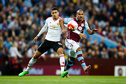 Chris Smalling of Manchester United and Gabriel Agbonlahor of Aston Villa compete for the ball - Mandatory byline: Rogan Thomson/JMP - 07966 386802 - 14/08/2015 - FOOTBALL - Villa Park Stadium - Birmingham, England - Aston Villa v Manchester United - Barclays Premier League.