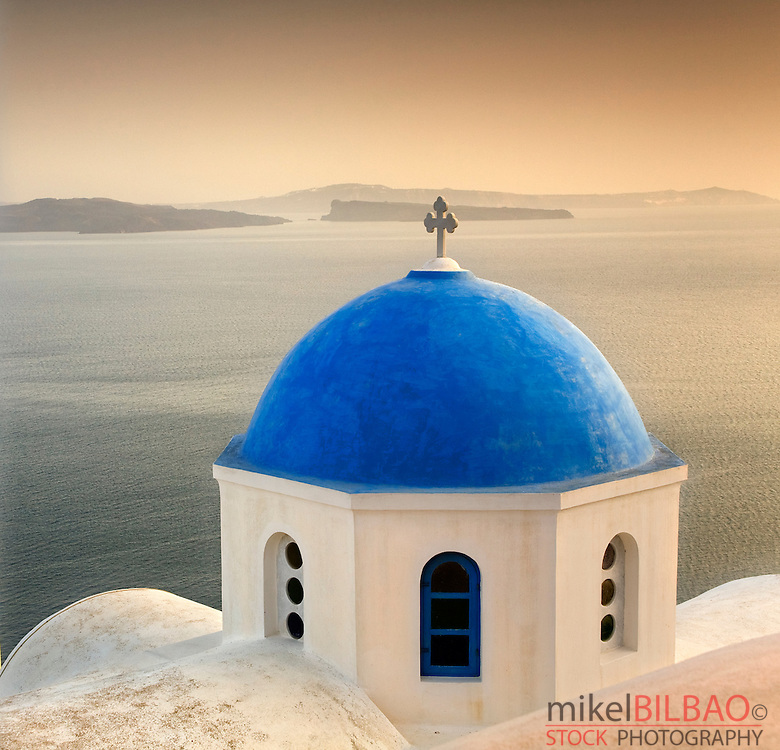 Orthodox church dome and sea.<br /> Oia village. <br /> Santorini island. Cyclades islands, Aegean Sea, Greece, Europe.