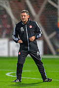 Abderdeen assistant manager Tony Docherty watches his players during the warm up before the Betfred Scottish Football League Cup quarter final match between Heart of Midlothian FC and Aberdeen FC at Tynecastle Stadium, Edinburgh, Scotland on 25 September 2019.