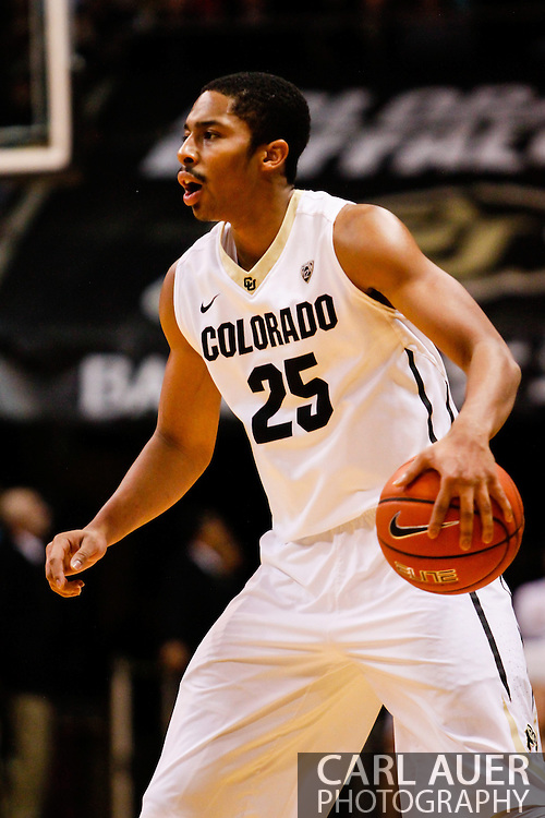 December 28th, 2013:  Colorado Buffaloes junior guard Spencer Dinwiddie (25) runs the offense in the first half of action in the NCAA Basketball game between the Georgia Bulldogs and the University of Colorado Buffaloes at the Coors Events Center in Boulder, Colorado