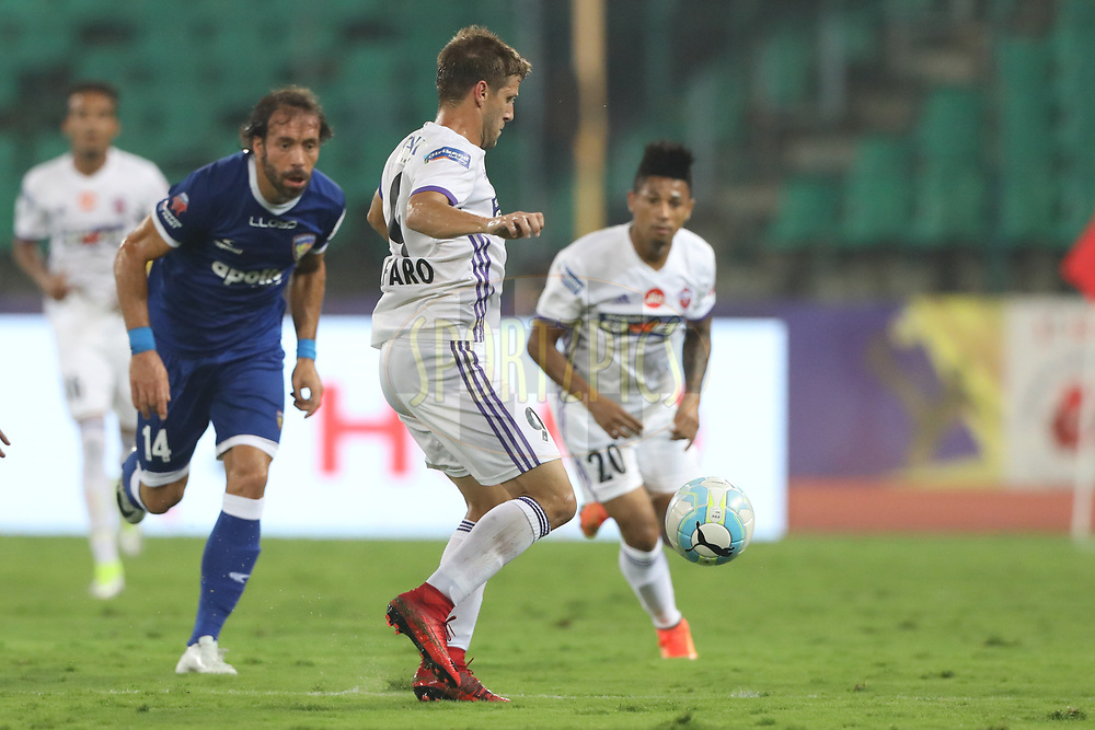 Emiliano Alfaro of FC Pune City and Dhanpal Ganesh of Chennaiyin FC during match 46 of the Hero Indian Super League between Chennaiyin FC and FC Pune City held at the Jawaharlal Nehru Stadium, Chennai India on the 13th January 2018<br /> <br /> Photo by: Arjun Singh  / ISL / SPORTZPICS