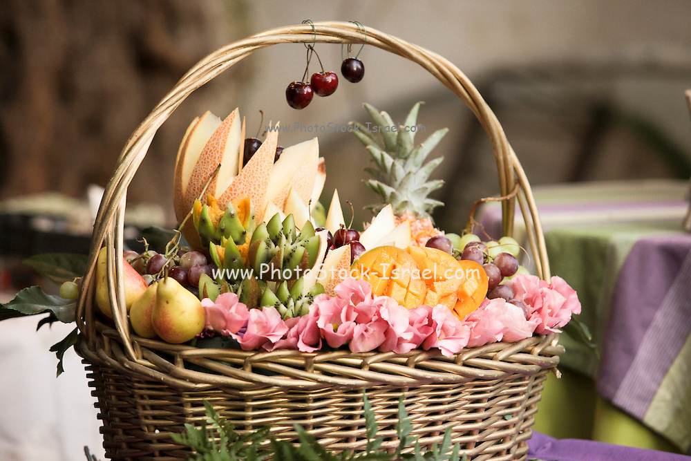 Arranging a decorative fruit basket