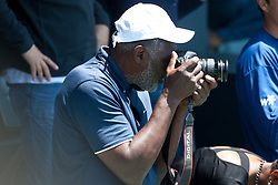 July 31, 2011; Stanford, CA, USA;  Richard Williams takes photographs of his daughter Serena Williams (USA), not pictured, after her match against Marion Bartoli (FRA), not pictured, during the finals of the Bank of the West Classic women's tennis tournament at the Taube Family Tennis Stadium. Williams defeated Bartoli 7-5, 6-1.