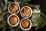 Eggplant zuccotto in baking dishes, decorated with fir branches, top view.