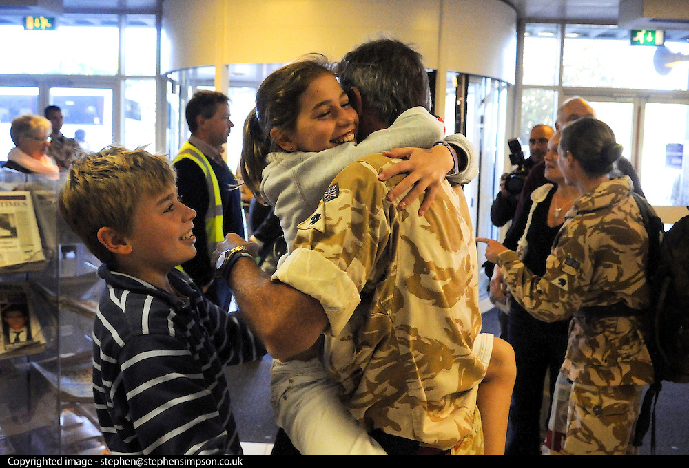 12/10/2009 Lt Col Nick Richardson is greeted by his daughter Eleanor and son Thomas on his arrival back from a tour of Afghanistan...