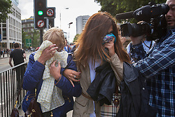 © licensed to London News Pictures. London, UK 09/08/2013. Domenico Rancadore's wife Anne Rancadore (left) and daughter Daniela Skinner (left) leaving Westminster Magistrates' Court in London on Friday, August 09, 2013. Photo credit: Tolga Akmen/LNP