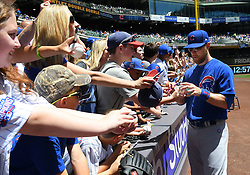 June 13, 2018 - Milwaukee, WI, U.S. - MILWAUKEE, WI - JUNE 13: Chicago Cubs Infield Ben Zobrist (18) signs autographs before a MLB game between the Milwaukee Brewers and Chicago Cubs on June 13, 2018 at Miller Park in Milwaukee, WI. The Brewers defeated the Cubs 1-0.(Photo by Nick Wosika/Icon Sportswire) (Credit Image: © Nick Wosika/Icon SMI via ZUMA Press)