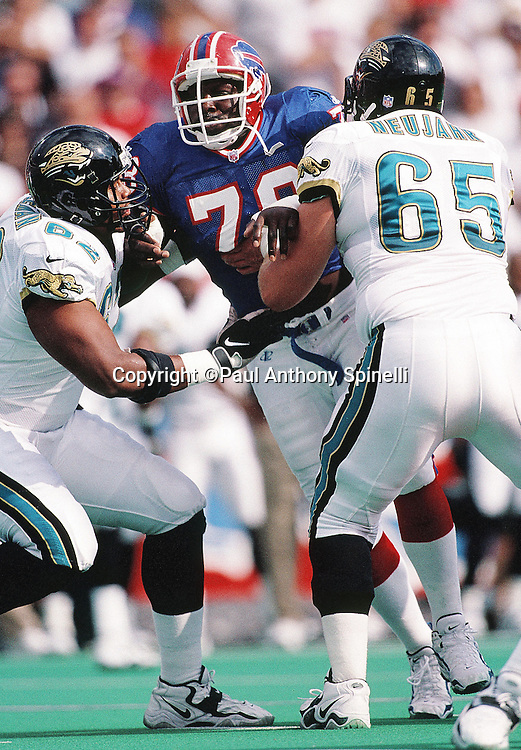 Buffalo Bills defensive end Bruce Smith (78) works his way through a double team block during the NFL football game against the Jacksonville Jaguars on Oct. 18, 1998 in Orchard Park, N.Y. The Bills won the game 17-16. (©Paul Anthony Spinelli)