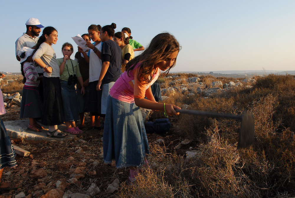 Young Israeli settlers during construction of the illegal outpost of Givat Tzuria near the Jewish settlement of Avnei Hefetz, located East of the West Bank Palestinian city of Tulkarem, July 28, 2009.