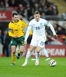 Ross Barkley of England (Everton) battles for the ball with Tadas Kijanskas of Lithuania   - Photo mandatory by-line: Joe Meredith/JMP - Mobile: 07966 386802 - 27/03/2015 - SPORT - Football - London - Wembley Stadium - England v Lithuania - UEFA EURO 2016 Qualifier