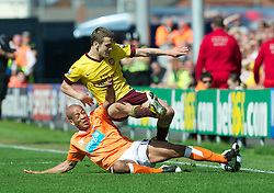 BLACKPOOL, ENGLAND - Sunday, April 10, 2011: Arsenal's Jack Wilshere and Blackpool's Alex Baptiste during the Premiership match at Bloomfield Road. (Photo by David Rawcliffe/Propaganda)