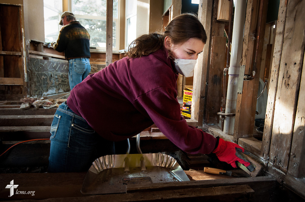 "Kelsey Bergquist, a student with Mt. Calvary Lutheran Student Fellowship at South Dakota State University, helps gut the interior of a home damaged by the September flooding on Wednesday, Jan. 8, 2014, in Lyons, Colo. Bergquist is one of seven students and one vicar who traveled to the ravaged area for volunteer relief work. ""We are His hands and feet to serve the community,"" Bergquist said. They leave for home on Saturday. LCMS Communications/Erik M. Lunsford"