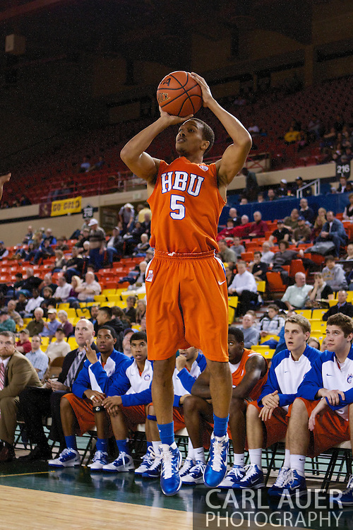 November 25th, 2010:  Anchorage, Alaska - Houston Baptist guard, Miles Dixon (5) attempts a three point shot in the Huskies 55-73 loss to Arizona State in a first round game of the Great Alaska Shootout.