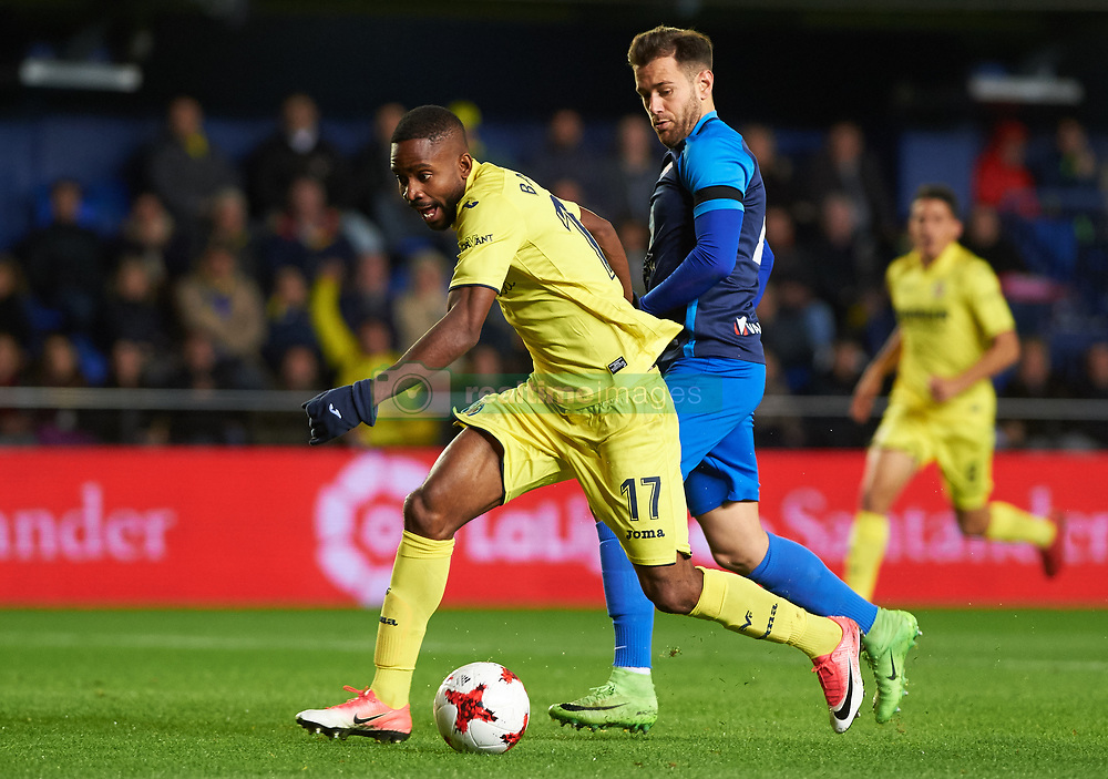 November 30, 2017 - Vila-Real, Castellon, Spain - Cedric Bakambu of Villarreal CF and Alvaro Moreno of SD Ponferradina during the Copa del Rey, Round of 32, Second Leg match between Villarreal CF and SD Ponferradina at Estadio de la Ceramica on november 30, 2017 in Vila-real, Spain. (Credit Image: © Maria Jose Segovia/NurPhoto via ZUMA Press)