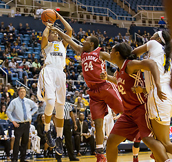 West Virginia Mountaineers forward Averee Fields (5) shoots over Oklahoma Sooners guard Sharane Campbell (24) during the second half at the WVU Coliseum.