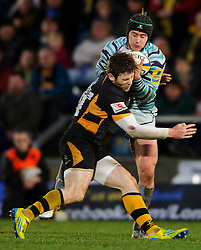 Leicester Full Back (#15) Mathew Tait takes a high bal as Wasps Outside Centre (#13) Elliot Daly comes in to tackle during the second half of the match - Photo mandatory by-line: Rogan Thomson/JMP - Tel: Mobile: 07966 386802 25/11/2012 - SPORT - RUGBY - Adams Park - High Wycombe. London Wasps v Leicester Tigers - Aviva Premiership.