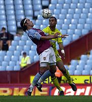 Photo: Greig Cowie.<br /> 20/09/2003.<br /> Barclaycard Premiership. Aston Villa v Charlton Athletic.<br /> Juan Pablo Angel controls as Jon Fortune covers