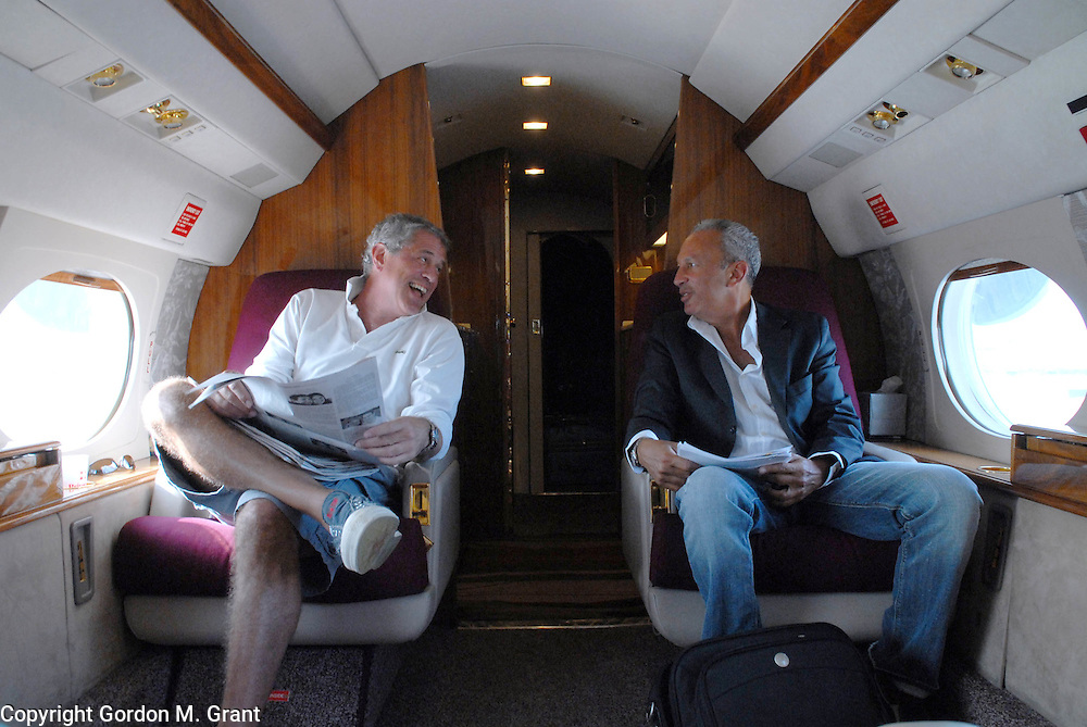 Westhampton Beach, NY - 8/13/06 -   (l-r) Robert Futterman and David Edelstein speak onboard a plane to go to Las Vegas for business at Gabreski Airport in Westhampton Beach, NY August 13, 2006.    (Photo by Gordon M. Grant)<br />