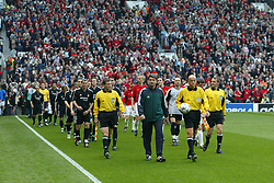 MANCHESTER, ENGLAND - Wednesday, April 23, 2003: Referee Pierluigi Collina leads out Real Madrid and Manchester United before the UEFA Champions League Quarter Final 2nd Leg match at Old Trafford. (Pic by David Rawcliffe/Propaganda)