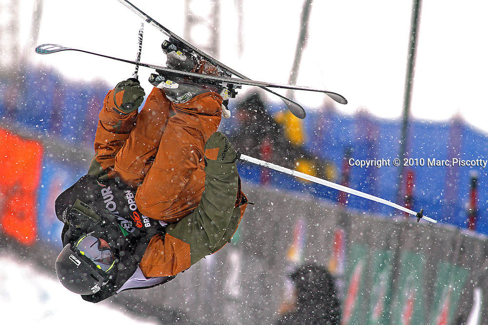 SHOT 12/18/10 10:42:58 AM - Torin Yater-Wallace of Basalt, Co. gets inverted while competing in the Superpipe Finals during the Nike 6.0 Open stop of the Winter Dew Tour at Breckenridge Ski Resort in Breckenridge, Co. Yater-Wallace is only 15 years old and finished in fifth with a score of 83.25. It was his first time competing professionally. The event features ski and snowboard slopestyle and superpipe. (Photo by Marc Piscotty / © 2010)