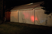 large event party tent during night seen from the outside