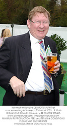 Irish multi-millionaire DERMOT SMURFIT at a race meeting in Surrey on 25th April 2003.			PJD 66