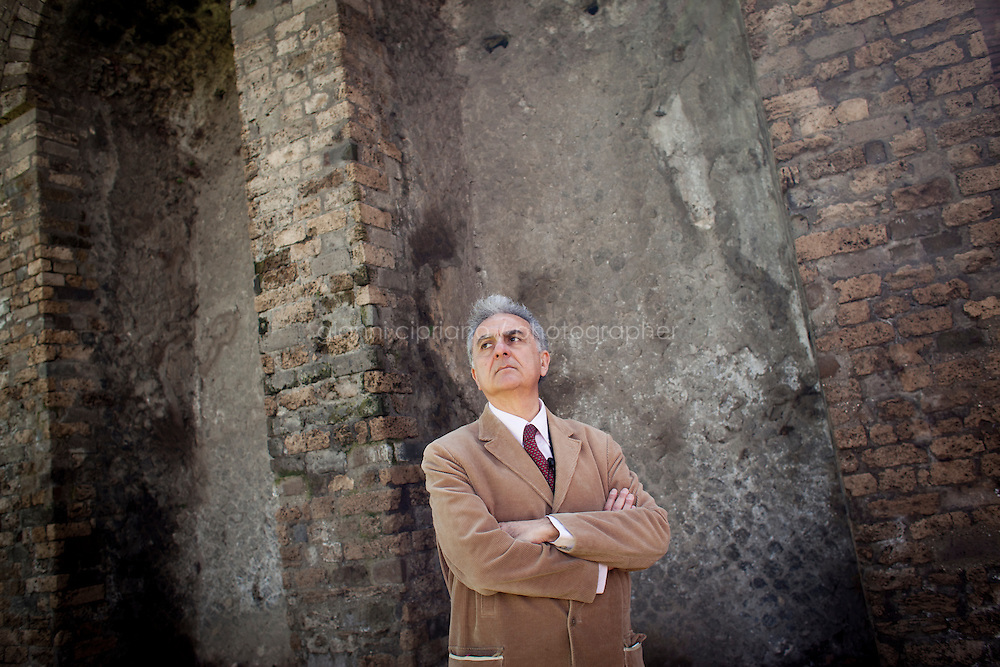 POMPEII, ITALY - 5 APRIL 2013: Architect Antonio Irlando, founder of the watchdog OPC Italia investigating on the archeological site of Pompeii, stands by the Amphitheater (70BC), one of the oldest and best preserved aphitheaters in existence which held 20,000 spectators, in Pompeii, Italy, on April 5th, 2013.<br /> <br /> In recent years, a series of collapses at the site have alarmed conservationists, who warn that the ancient Roman city is dangerously exposed to the elements ? and poorly served by the red tape, lack of strategic planning and limited personnel of the site's historically troubled management. <br /> <br /> Pompeii, along with Herculaneum, was buried under 4 to 6 meters (13 to 20 ft) of ash and pumice in the eruption of Mount Vesuvius in 79 AD. After its initial discovery in 1599, Pompeii was rediscovered as the result of intentional excavations in 1748 by the Spanish military engineer Rocque Joaquin de Alcubierre.<br /> <br /> Pompeii is an UNESCO World Heritage Site and one of the most popular tourist attractions of Italy, with approximately 2.5 million visitors every year.<br /> <br /> Gianni Cipriano for The New York Times